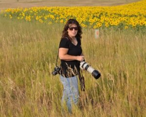 Admin K.S. Brooks with sunflowers by janice viens