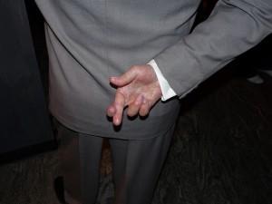 crossed-fingers lying book description