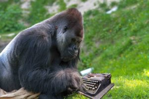 Ape using a typewriter