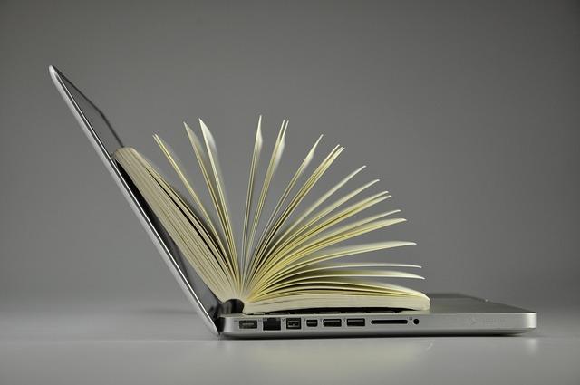 book inside a laptop courtesy of Pixabay.com